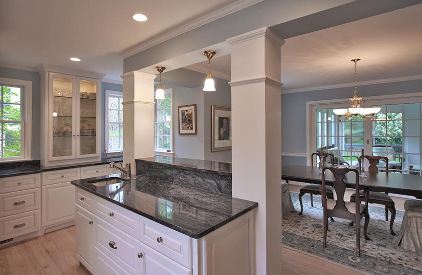 A kitchen island with a view into the dining room